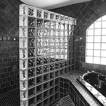 Bathroom stone tile work and glass block creations