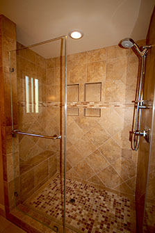 Glass blocks and stone tile in a bathroom remodel.