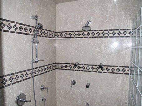 Stone, tiling and glass blocks in a custom shower stall.