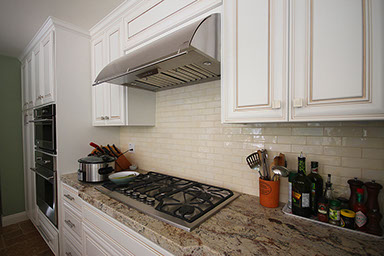 Granite countertop and ceramic wall tiles backsplash by Rock Solid Creations in California.